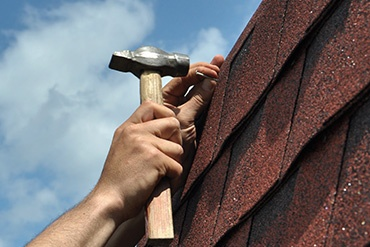 roof repairs and/or roof replacement